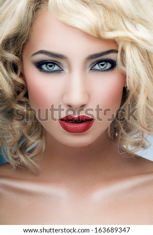 Shot of a blond woman with red lipstick