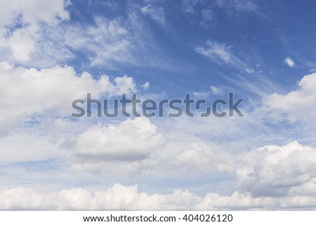 Shot of a Blue Sky with Fluffy Clouds - stock photo