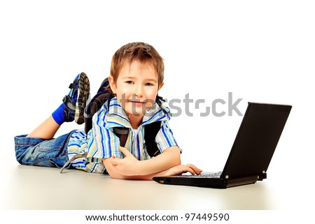 Shot of a boy with his laptop. Isolated over white background.
