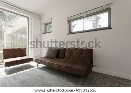 Shot of a brown sofa in a spacious modern house