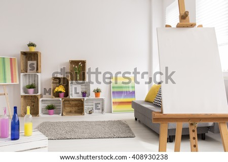 Shot of a colorful modern room with an easel and colorful decorations