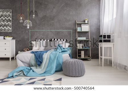 Shot of a comfortable bedroom interior designed in grey tones