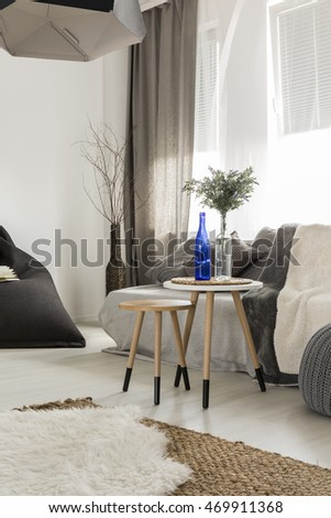 Shot of a cosy living room interior, designed in grey tones