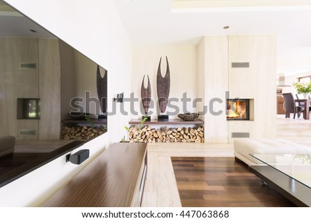 Shot of a cozy modern living room with a big TV