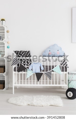 Shot of a crib in a scandinavian style baby room - stock photo