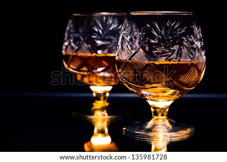shot of a cut crystal glass containing brandy. - stock photo