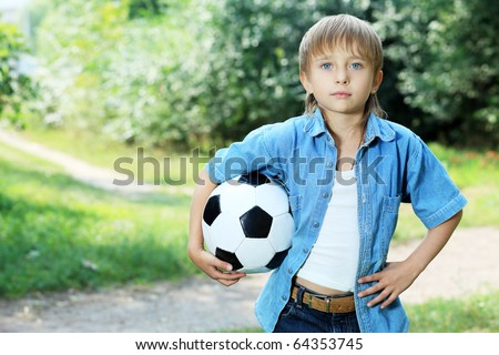 Shot of a cute boy with a ball outdoor.