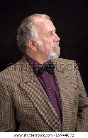 Shot of a distinguished older man with a serious look on his face.