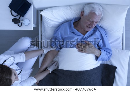 Shot of a doctor examining a senior patient - stock photo