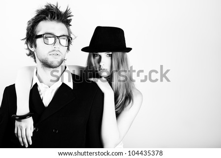 Shot of a fashionable young people posing in studio. - stock photo