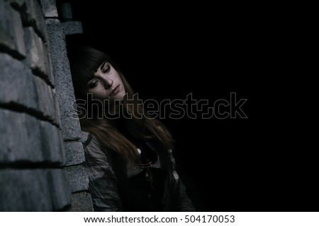 Shot of a gothic woman in autumn park