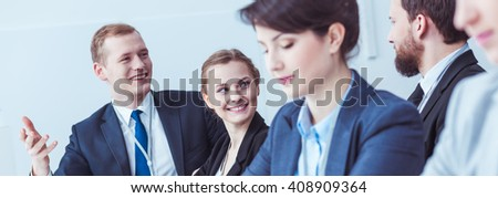 Shot of a group of young businessmen and businesswomen having a meeting