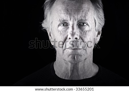 Shot of a Handsome Senior Man against a Dark Background - stock photo