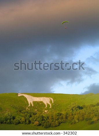 Shot of a hanglider over Westbury White Horse - stock photo