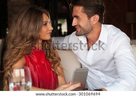Shot of a happy couplein restourant - stock photo