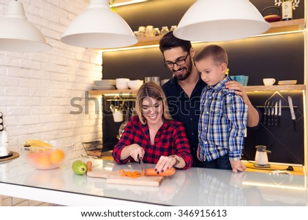 Shot of a happy family making lunch together.