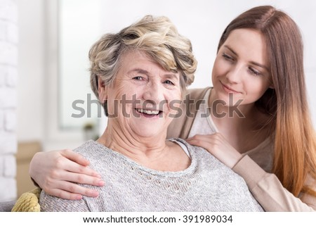 Shot of a happy senior woman and her granddaughter hugging her