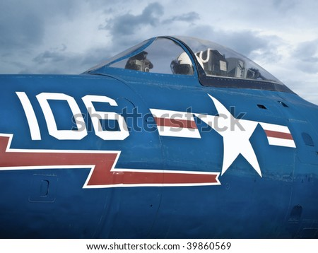 shot of a jet pilot in a blue air force jet fighter.