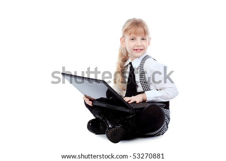 Shot of a little girl sitting on a floor with her laptop. Isolated over white background.
