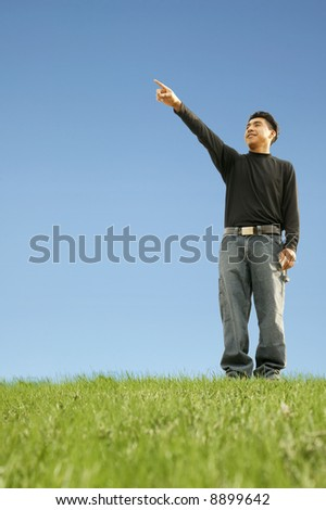 shot of a man pointing out representing pointing at future target or goal. with copyspace