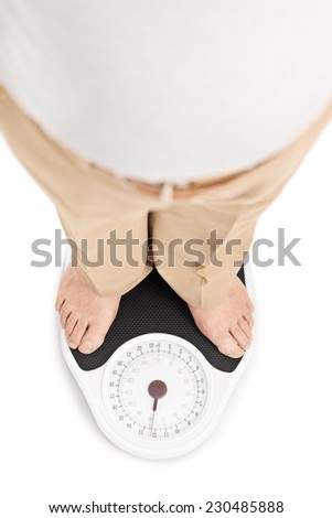 Shot of a man standing on a weight scale isolated on white background - stock photo