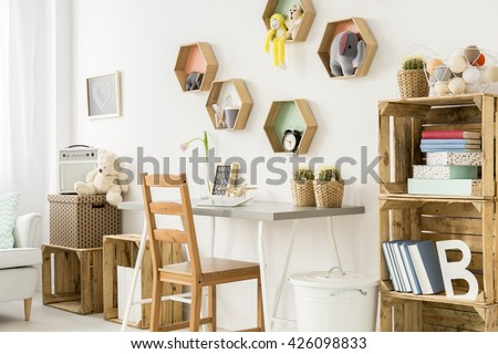 Shot of a modern children's room full of wooden furniture