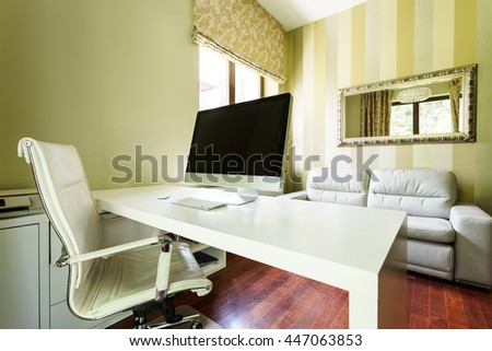 Shot of a modern home office with a big desk and a computer