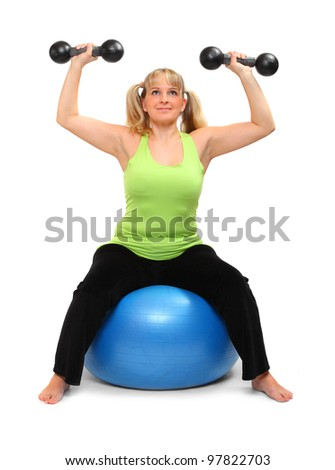 Shot of a overweight young woman exercise on a fitness ball against white background.