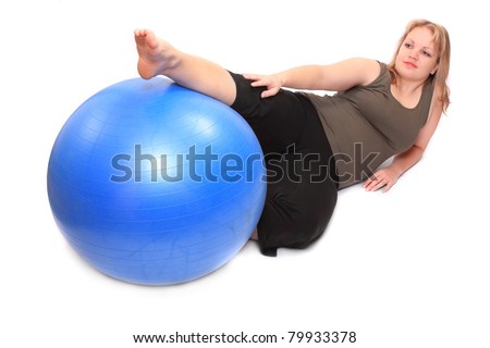 Shot of a overweight young woman with blue ball on a white background.