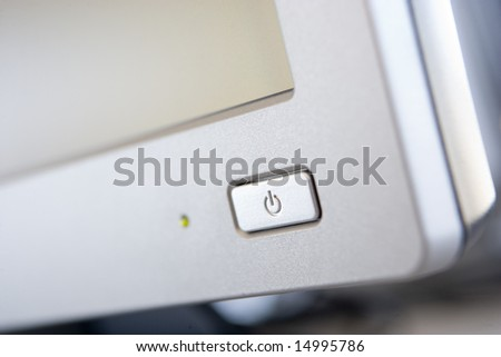 Shot of a power button on a computer monitor - stock photo