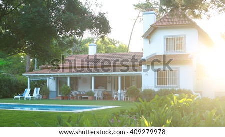 Shot of a residential home during golden hour. - stock photo