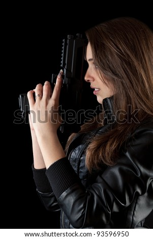 Shot of a sexy girl posing with guns. - stock photo