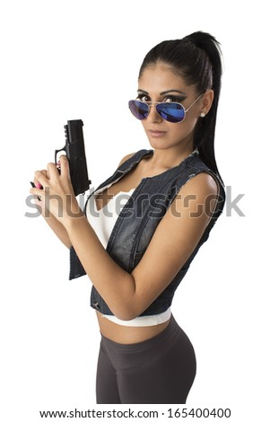 Shot of a sexy military woman posing with guns - stock photo