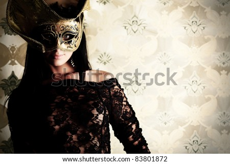 Shot of a sexy woman in erotic lingerie over vintage background. - stock photo