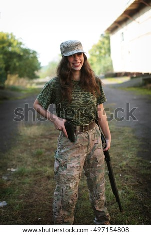 Shot of a sexy woman in military uniform posing