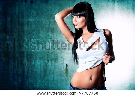Shot of a sexy woman posing outdoor. - stock photo