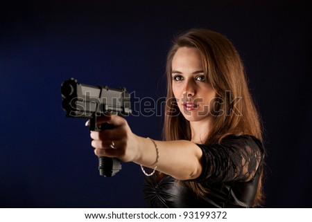 Shot of a sexy woman posing with guns.