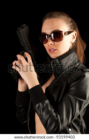 Shot of a sexy woman posing with guns in sunglass - stock photo
