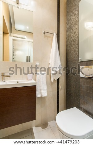 Shot of a small modern brown and white bathroom