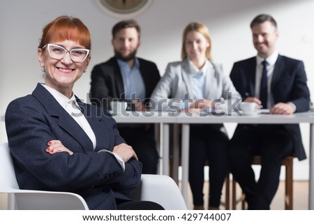 Shot of a smiling businesswoman and her colleagues