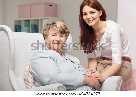 Shot of a smiling senior woman and her daughter looking at the camera