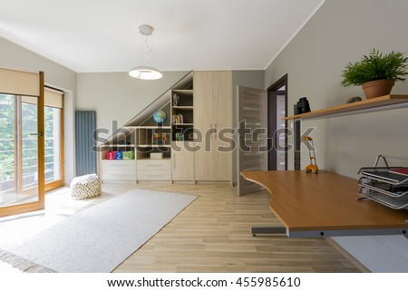 Shot of a spacious kids room interior with a wooden floor