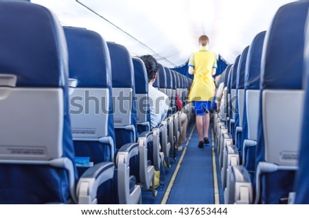 shot of a stewardess in the plane  - stock photo