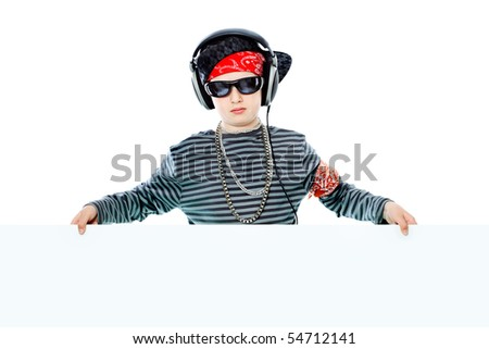 Shot of a trendy teenager listening to music in headphones and holding white board. Isolated over white background.