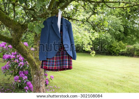 shot of a Wedding Kilt Hanging on wooden frame - stock photo