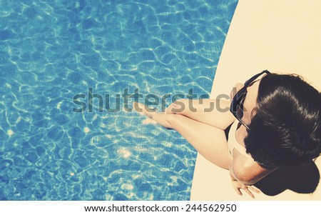 Shot of a Woman by Pool - stock photo