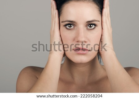 Shot of a Woman Covering her Ears  - stock photo
