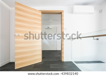 Shot of a wooden door in a modern house