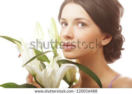 Shot of a young beautiful woman with a lily flowers