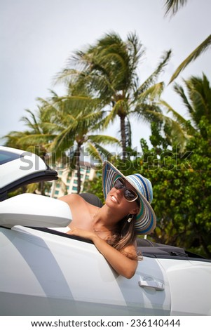 Shot of a young beautiful women enjoying drive in convertible car. Summer travel holidays vacation. Honolulu, HI, United States Island of Oahu - stock photo